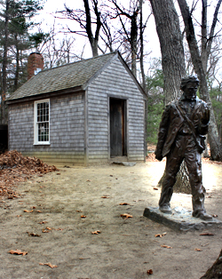 The Thoreau cabin replica and statue at Walden Pond State Reservation