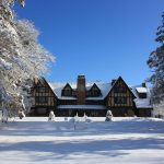 Thoreau Institute main building and front lawn blanketed in new snow